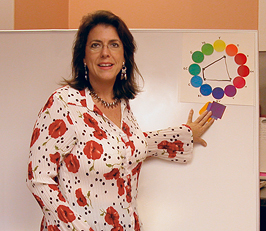 Margie at whiteboard with color wheel